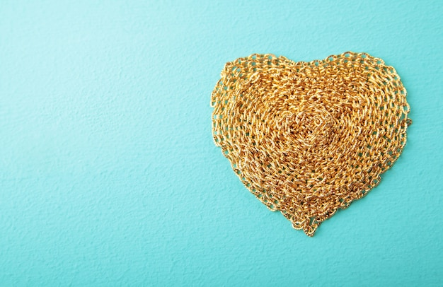 Heart made with gold chain wood texture