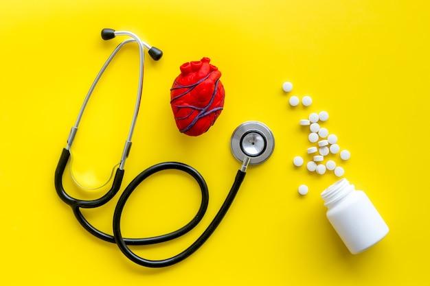 Heart near pills tonometer, treatment on yellow