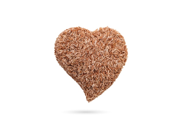 Heart organic brown rice on white isolated