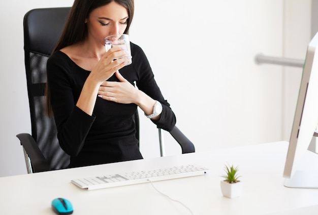 Heart pain. woman having panic attack at workplace