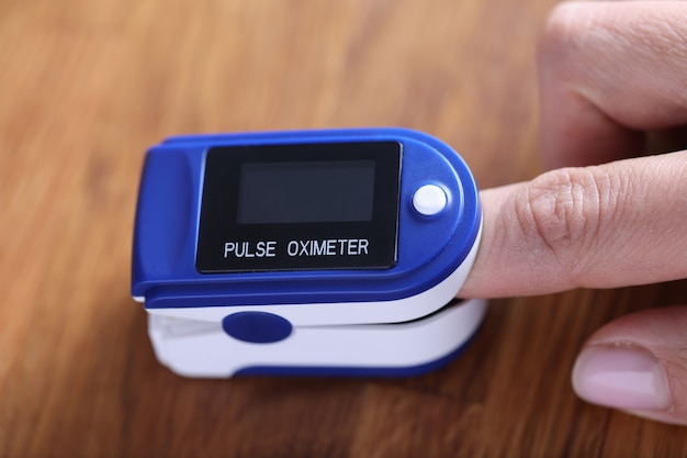 Heart rate monitor is fixed on the finger. heart rate parting concept