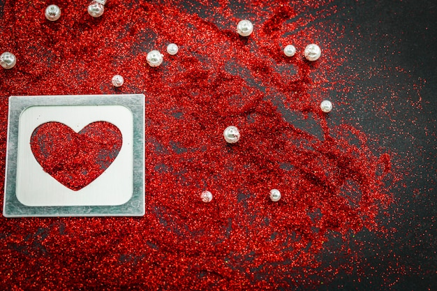 Heart of sequins on a black, valentine day love concept