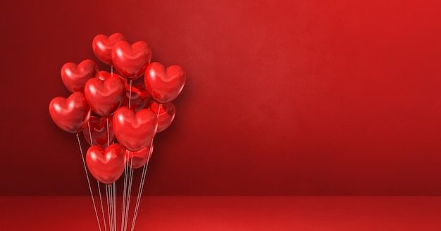 Пучок воздушных шаров в форме сердца на фоне красной стены. горизонтальный баннер. 3d визуализация иллюстрации