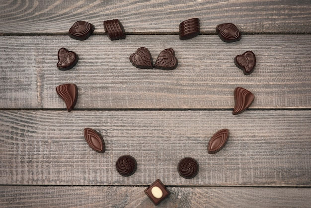 Heart shape composition of chocolate candies