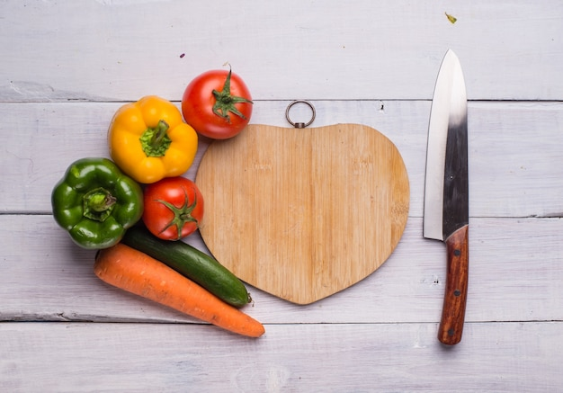 Heart shape cutting board with food