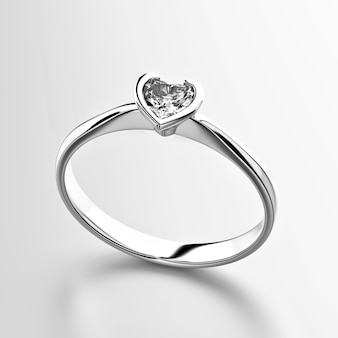 白い背景で隔離のハート形のダイヤモンドリング
