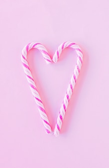 Heart shape from candy canes on table