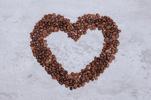 Heart shape from coffee beans with copy space in the middle