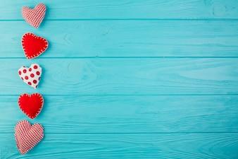 Heart shape handmade toys on turquoise wood