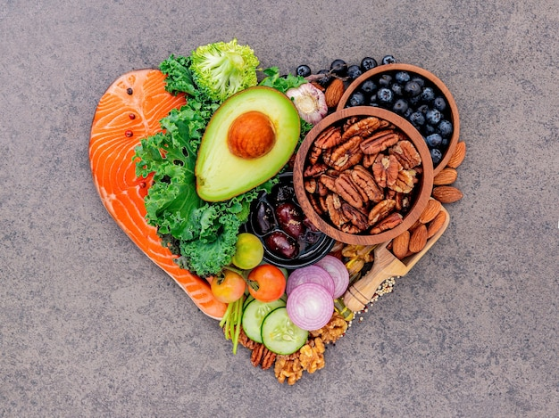 Heart shape of ketogenic low carbs diet concept on dark stone background.