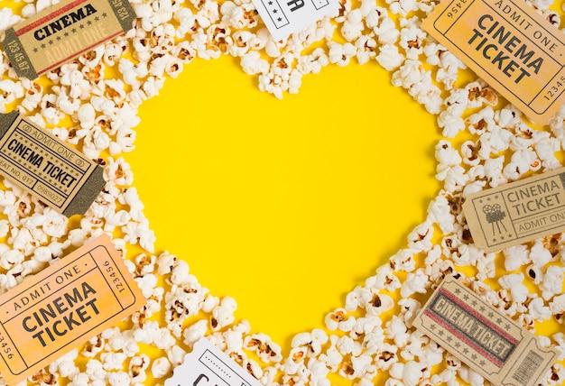 Heart shape of popcorn and cinema tickets