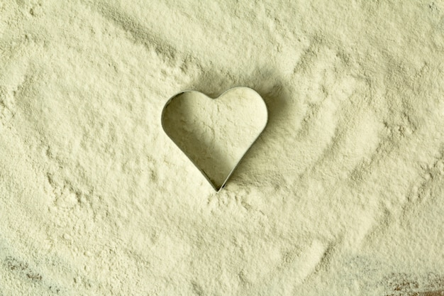 Heart shape in the sifted flour