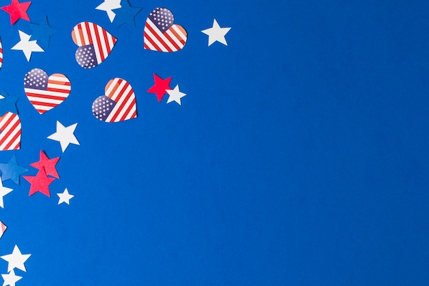 Heart shape usa flags and stars on blue background