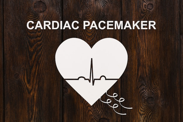 Heart shape with echocardiogram and cardiac pacemaker text