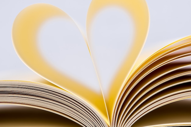Heart shaped book. book page in heart shape, focus on foreground.