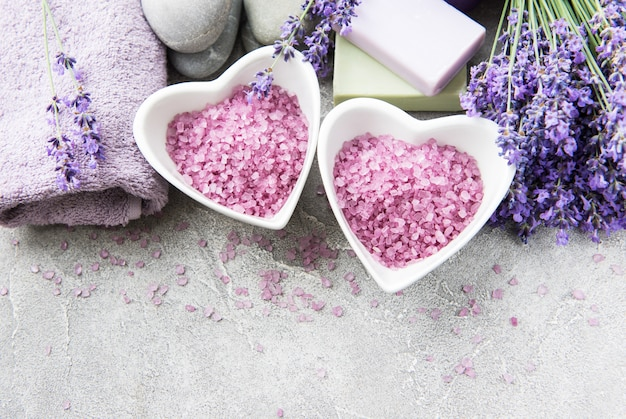 Heart-shaped bowl with sea salt, soap and  lavender flowers