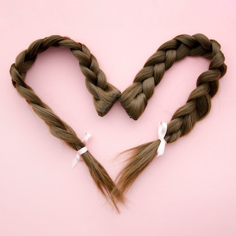 Heart shaped braided hair with ribbon