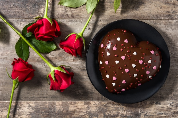 Heart shaped cake and red roses