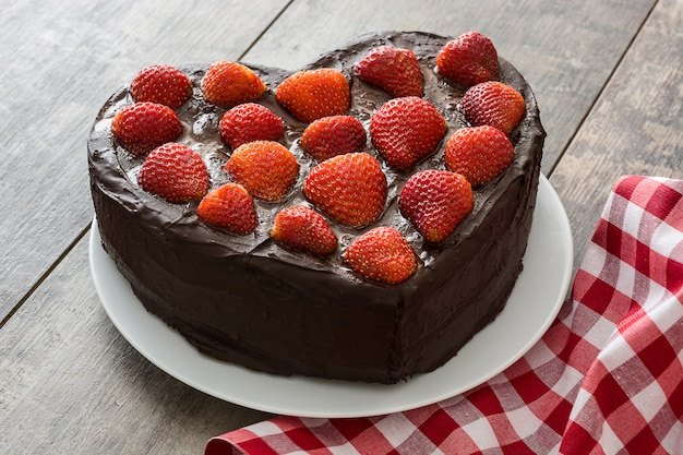 Heart shaped cake for valentine's day or mother's day on wooden surface