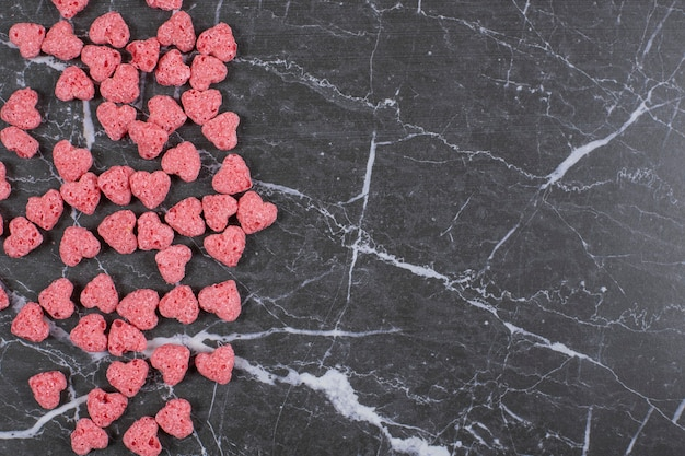 Heart shaped cereal flakes on marble.