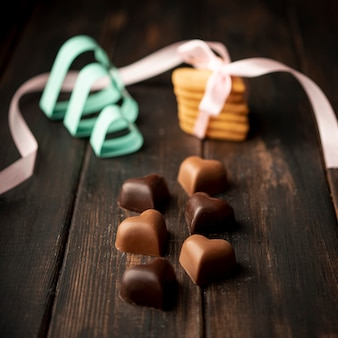 Heart-shaped chocolates with cookies and ribbon