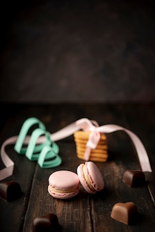 Heart-shaped chocolates with macarons and copy space