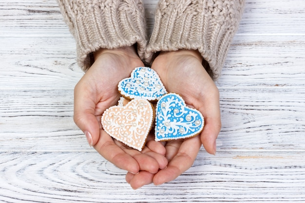 Heart shaped cookie in woman's hands holiday cookies