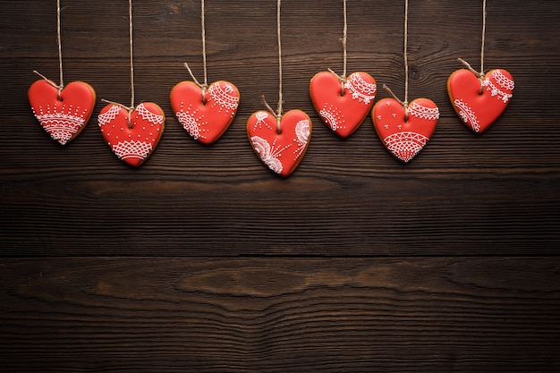 Heart-shaped cookies hanging from ropes