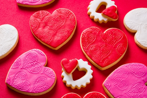 Heart-shaped cookies for valentine's day on red top view