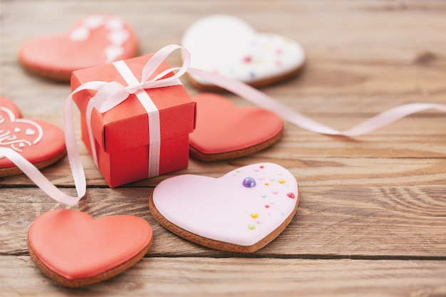 Heart shaped cookies with gift box for valentine's day or mother's day on wooden background.