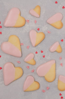 Heart-shaped cookies with pink chocolate glaze for valentine's day