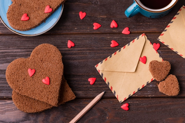 Heart-shaped cookies with sprinkles and envelope