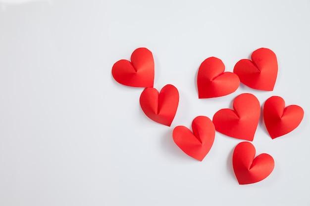 Heart-shaped cut paper arrange as background.