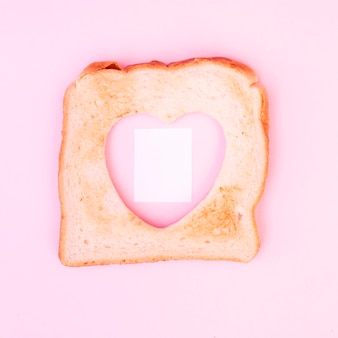 Heart-shaped cutout in toast