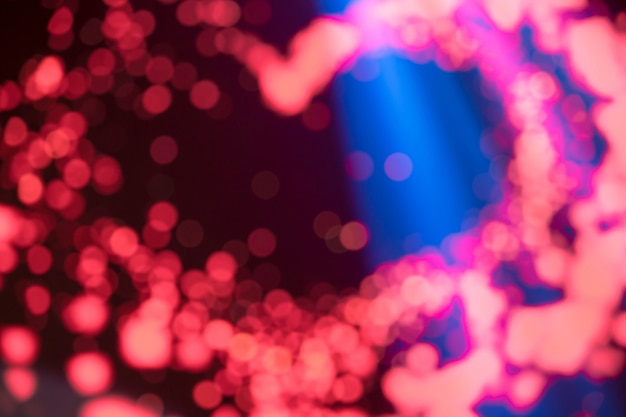 Heart shaped of disfocus of pink led background