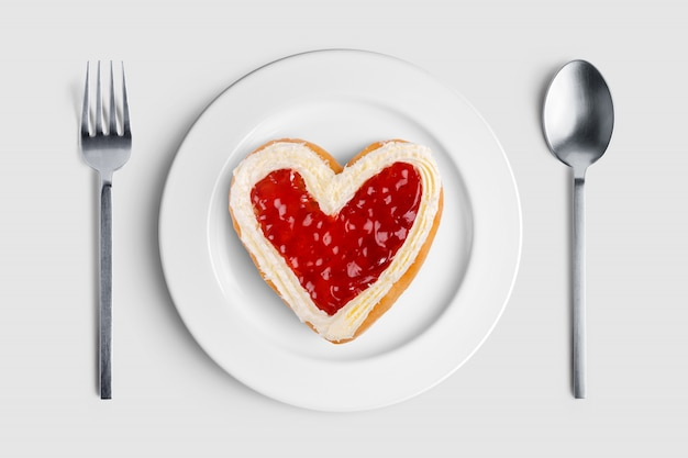 Heart shaped donut on white plate for valentine's day