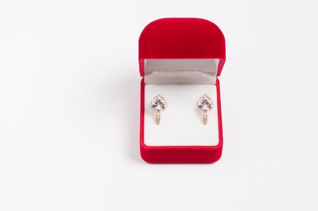 Heart shaped earrings in a red box