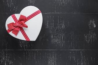 Heart-shaped gift box on black background
