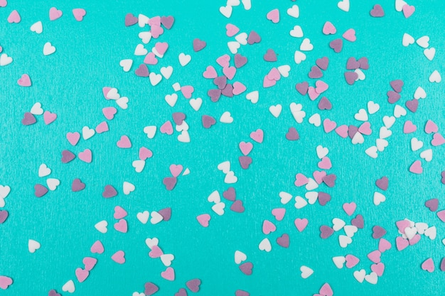 Heart shaped little cookies decoration on blue surface