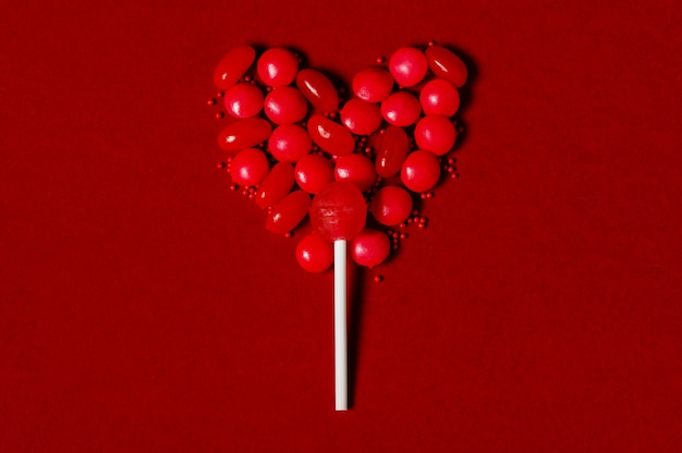 Heart-shaped lollipop made of sweets