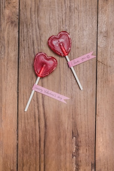 Heart-shaped lollipops on a wooden table
