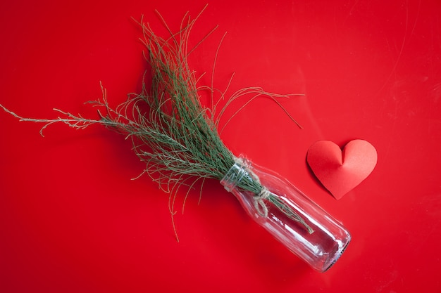 Heart-shaped paper and glass jar arrange as background.