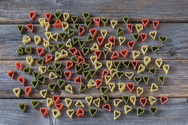 Heart-shaped pasta scattered across the background