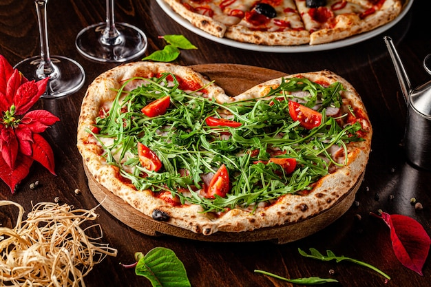 Heart shaped pizza with arugula