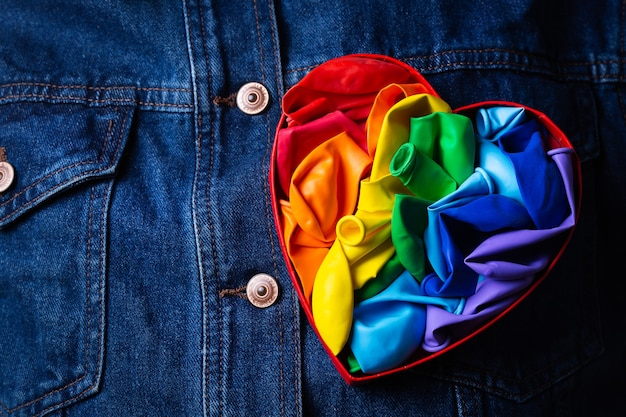 Heart shaped rainbow lgbtq flag against denim background pride month