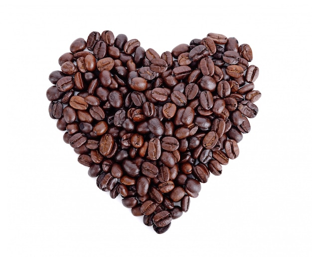 Heart shaped roasted coffee beans on white