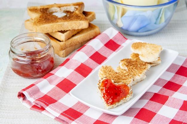 Heart-shaped toast with jam