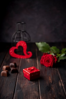 Heart-shaped valentines day chocolates with present and rose
