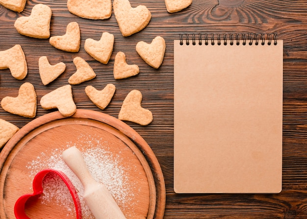 Heart-shaped valentines day cookies with notebook