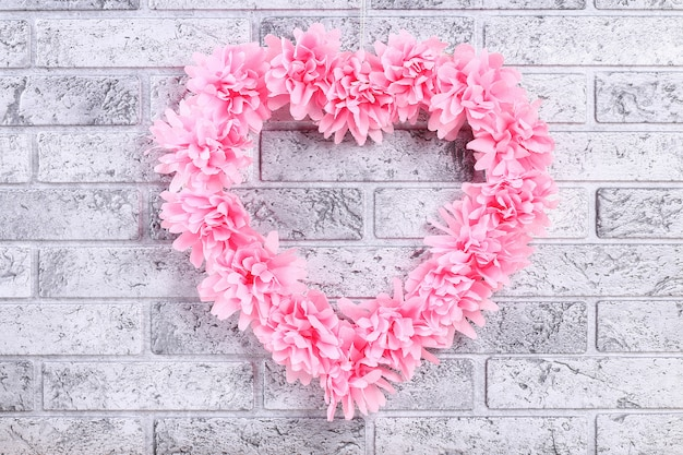 Heart shaped wreath decorated artificial flower made pink tissue paper napkins